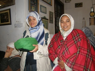 Holding Mawlana's turban